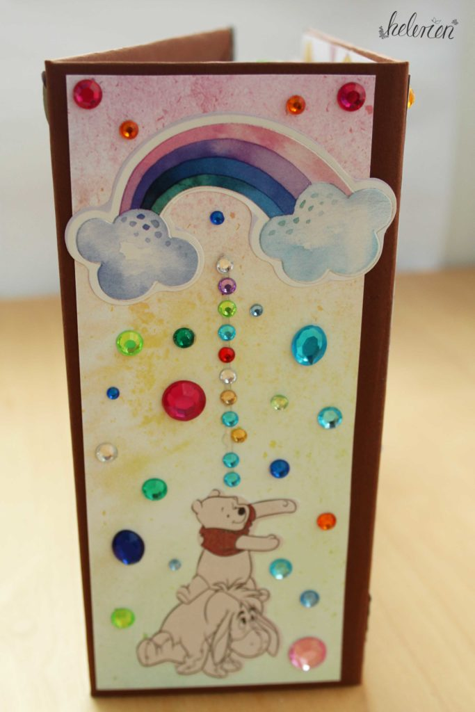 Buchrücken mit einem Regenbogen, Winniepooh und I-Ah und sehr vielen Glitzersteinen