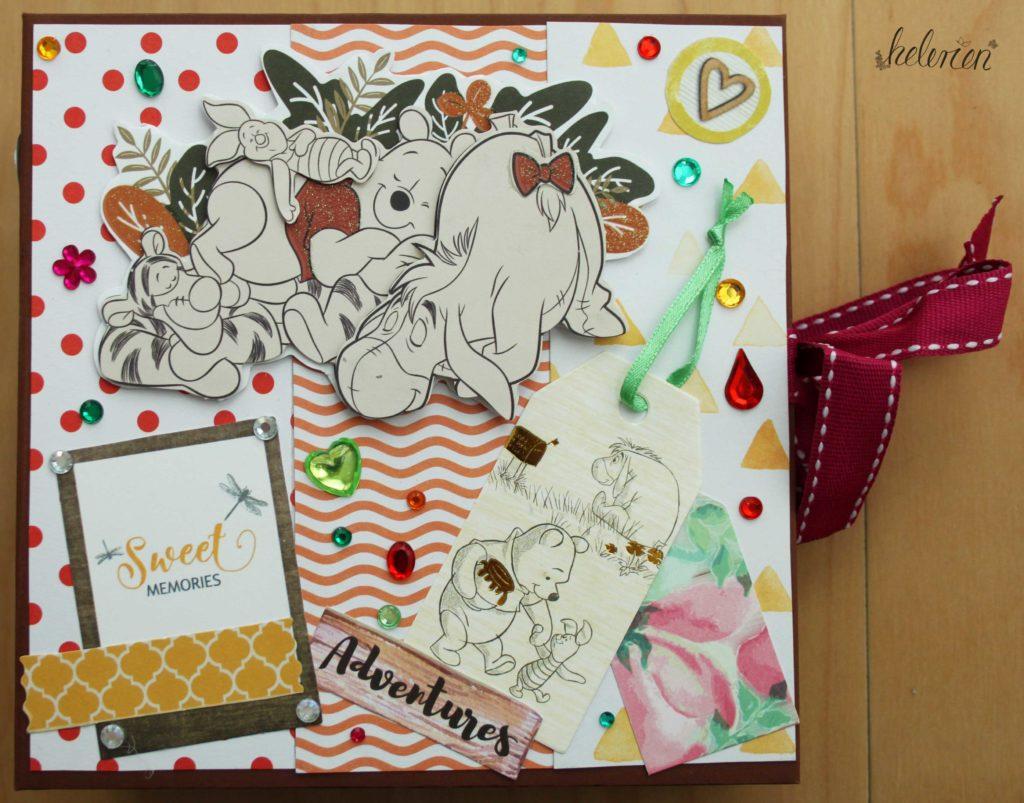 Ein buntes Cover mit Winnie Pooh Motiven, viel Glitzersteinen und einigen Stanzteilen in gelb und orange