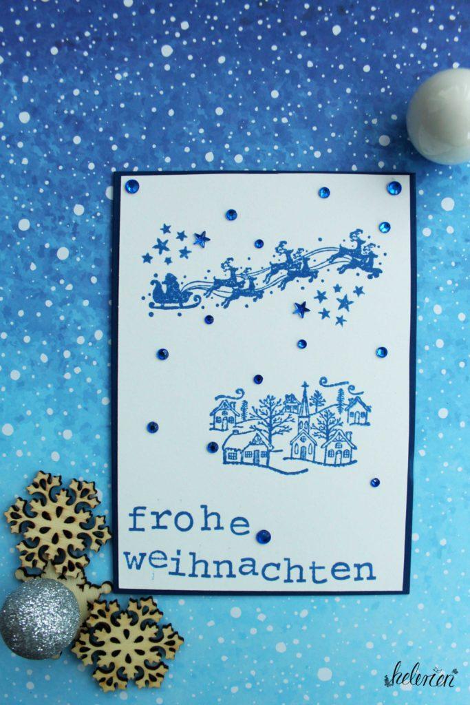 blaue Weihnachtsmannschlittenkarte